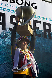 December 18, 2017 - Banzai Pipeline, HI, USA - BANZAI PIPELINE, HI - DECEMBER 18, 2017 - John John Florence of Hawaii holds up the trophy after winning the World Surf League World Title at the Billabong Pipe Masters. (Credit Image: © Erich Schlegel via ZUMA Wire)
