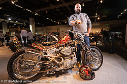 Alessio Mattiazzi with his Harley-Davidson 1,000cc Ironhead XLCH custom that he fabricated in his home garage and painted at 70's helmets in Vicenza where he works is an entry in the AMD World Championship of Custom Bikes at the Intermot International Motorcycle Fair. Cologne, Germany. Wednesday October 3, 2018. Photography ©2018 Michael Lichter.
