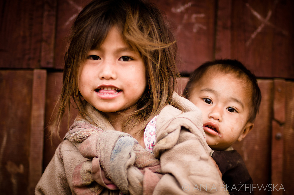 Laos, village in the Luang Nam Tha area. Khamu girl with her little brother.