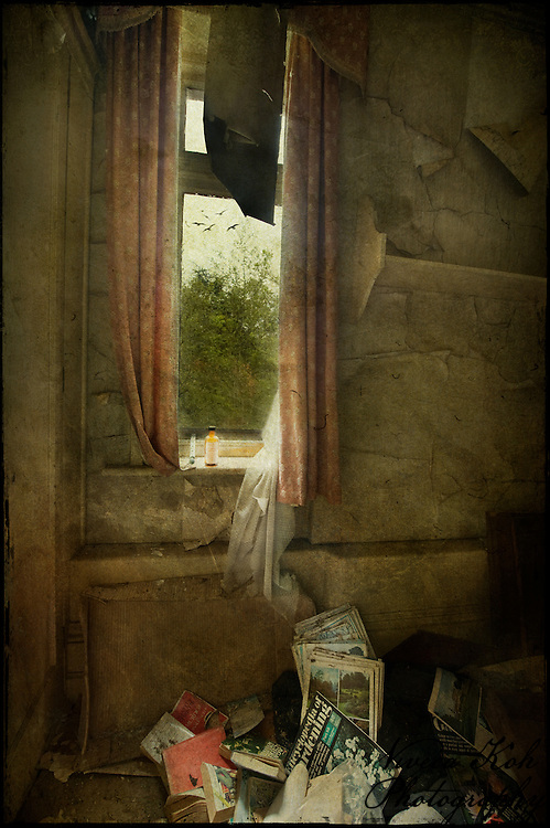 Looking out of a window in an abandoned house