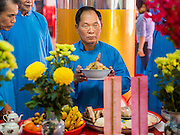 """09 FEBRUARY 2014 - HAT YAI, SONGKHLA, THAILAND: A man prays in the Chao Mae Tubtim Shrine (Ruby Goddess Shrine) on 108 Hainanese Ancestors Memorial Day in Hat Yai, Songkhla, Thailand. Hainanese communities around the world celebrate """"108 Hainanese Ancestors Memorial Day."""" The day honors the time when 109 Hainanese villagers fleeing life in Hainan (an island off of the southwest coast of China, near Vietnam) washed up in what is now Vietnam and were killed by Vietnamese authorities because authorities thought they were pirates. The Vietnamese built a temple on the site and named it """"Zhao Yin Ying Lie."""" Many Vietnamese fisherman credit prayers at the temple to saving their lives during violent storms and now """"108 Hainanese Ancestors Memorial Day"""" is celebrated in Hainanese communities around the world. Hat Yai, the economic center of southern Thailand has a large Hainanese population.    PHOTO BY JACK KURTZ"""
