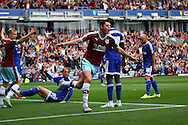 Michael Keane of Burnley celebrates after scoring his teams 1st goal. Skybet football league championship match, Burnley  v Brentford at Turf Moor in Burnley, Lancs on Saturday 22nd August 2015.<br /> pic by Chris Stading, Andrew Orchard sports photography.
