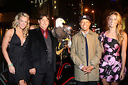 """l to r: Heidi Albertson, American Bald Eagle '' Challenger """" , Russell Simmnons and Jill Henderson at The Life Project for Africa Benefit for the NJIA Health Center in Tanzania, Africa and held at Ben and Jack's Restaurant on November 10, 2009 in New York City"""