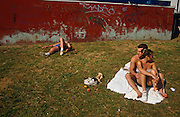 Despite a gloriously bright summer afternoon, we see a depressing corner of Southend-on-Sea's Adventure Island. A young couple sits on some white towels in front of a wall that is adorned with graffiti and has its paint rubbed away. It is a scene of squalor and desolation in a town that makes revenue from the day-tripper holiday market. Since Victorian times, many Londoners have traditionally come to this south-east coast on the Thames Estuary, close to the capital. Towns like this have seen a marked decline since the advent of the package tourism in favour of exotic beaches in Spain.