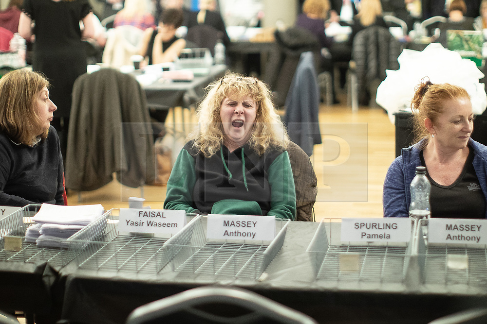 © Licensed to London News Pictures . 02/05/2019. Bolton, UK. A vote counter yawns . The count for Bolton Council at Bolton Town Hall . The Labour Party are threatened to lose their majority on the council . Local council elections are taking place across the country . Photo credit: Joel Goodman/LNP