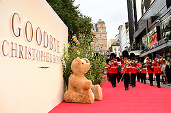 The Coldstream Guard brass band march past a giant teddy bear during the world premiere of Goodbye Christopher Robin at the Odeon in Leicester Square, London. See PA story SHOWBIZ Goodbye. Picture Date: Wednesday 20 September. Photo credit should read: Ian West/PA Wire