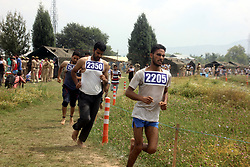 July 24, 2017 - Anantnag, Jammu and Kashmir, India - Kashmiri men run to qualify the test during a Police recruitment rally on  July 24, 2017 in Anantnag, India. A recruitment drive by the police in Kashmir evoked an overwhelming response, with nearly 3,000 young men and women turning up for it. The candidates, who have qualified the physical test, will have to appear in the written test for final selection for which the dates will be issued separately. (Credit Image: © Muneeb Ul Islam/Pacific Press via ZUMA Wire)