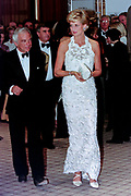 Diana, Princess of Wales walks with fashion designer Ralph Lauren, left, and Vogue Magazine editor Anna Wintour, right, during a charity gala fundraising event for the Nina Hyde Center for Breast Cancer Research September 24, 1996 in Washington, DC.