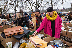 Visitors browsing second hand goods at Sunday market at Mauer Park in Prenzlauer Berg in Berlin, Germany