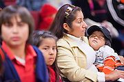 07 FEBRUARY 2011 - PHOENIX, AZ:  An immigrant woman and her US born son sits in a hearing room at the Arizona Capitol Monday, February 7. The Arizona State Legislature, led by the State Senate is debating the 14th Amendment, which would bar US citizenship for the children of undocumented immigrants born in the United States. The bill has broad support among Republicans, who are the majority party, in the state legislature but not among Democrats. The law is also very unpopular in the state's Latino and immigrant communities.       Photo by Jack Kurtz
