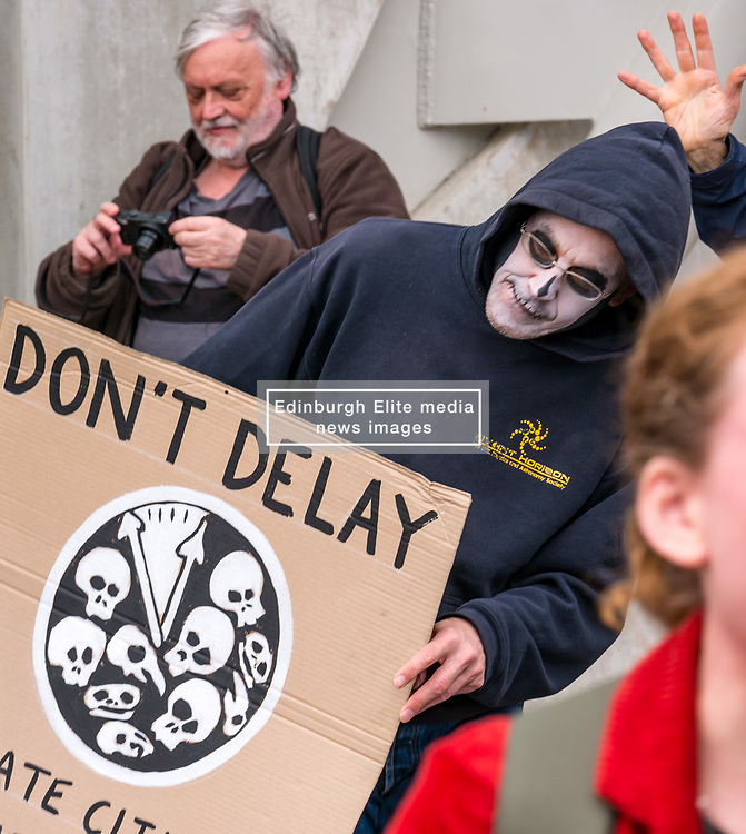 Pictured: Climate Change Protest. Scottish Parliament, Edinburgh, Scotland, United Kingdom, 20 June 2019. Climate change protestors outside the parliament, including Extinction Rebellion Scotland, protest in a mass theatrical dancing die-in along with jazz music. The protestors are campaigning for the Scottish Government to set a Net Zero Emissions by 2025 target when the Scottish Climate Bill is amended this month. The protestors set up a 'Holyrood Rebel Camp' outside the parliament for 5 days, culminating in today's event.<br /> <br /> Sally Anderson | EdinburghElitemedia.co.uk