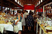 People shopping at a food market at Grasse, French Riviera, France 1974