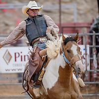 Saddle bronc rider Corey Lefebre makes a 71-point ride in the first round of the Lion Club Rodeo Thursday at Red Rock Park.