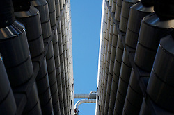 Stock photo of an upward view from between stacks of pipes