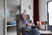 elderly man watching television during daytime