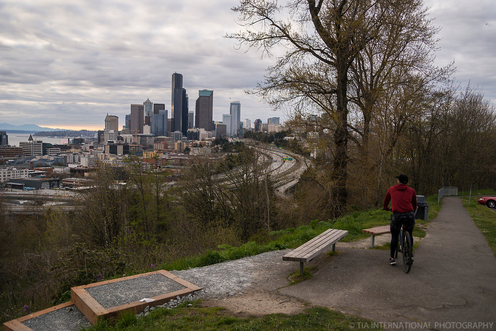 A cyclist arrives at the empty scenic outlook of the downtown skyline from the park. (April 5, 2020).