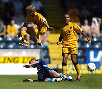 Fotball<br /> Foto: SBI/Digitalsport<br /> NORWAY ONLY<br /> <br /> Wycombe Wanderers v Cambridge United<br /> Coco-Cola League Two. 07/08/2004.<br /> <br /> Luke Guttridge leaps the tackle by Stuart Nethercott