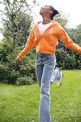 Portrait of a teenage girl skipping,