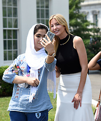 Ivanka Trump poses for a selfie with students in front of the West Wing at the White House, on July 20, 2017 in Washington, DC. Photo by Olivier Douliery/ Abaca