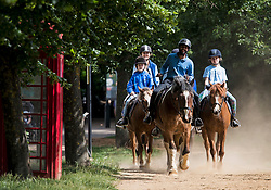 © Licensed to London News Pictures. 12/06/2021. London, UK. Members of the public ride horses around Hyde Park in central London on another hot summer's day. This weekend is expected to be the hottest of the year so far. Photo credit: Ben Cawthra/LNP