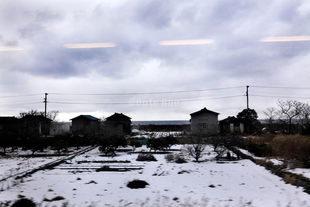 traveling by train through Toyama prefecture along the Sea of Japan