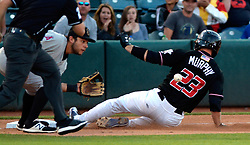 May 22, 2018 - U.S. - ASEC -- The Isotopes Tom Murphy, 23, beats the ball to Salt Lake third baseman David Fletcher on his triple Salt Lake in the 4th inning of the game in Isotopes Park on Tuesday, May 22, 2018. (Credit Image: © Greg Sorber/Albuquerque Journal via ZUMA Wire)