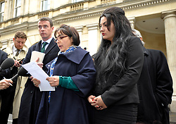 © Licensed to London News Pictures. 28/11/2013; Bristol, UK.  Manizhah Moores (centre), the sister of murder victim Bijan Ebrahimi and accompanied by the family's lawyer Tony Murphy, speaks to the media after sentencing during the trial at Bristol Crown Court.  Lee James age 24 was convicted of what is described as the vigilante murder of Bijan Ebrahimi in Bristol, and was sentenced to life imprisonment.  Accomplice Stephen Norley age 24 was sentenced to 4 years.  28 November 2013.<br /> Photo credit : Simon Chapman/LNP