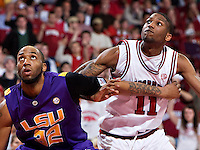 FAYETTEVILLE, AR - FEBRUARY 18:   Brandon Moore of the Arkansas Razorbacks tries to fight through a block out by Quintin Thornton of the LSU Tigers at Bud Walton Arena on February 18, 2009 in Fayetteville, Arkansas.  The Tigers defeated the Razorbacks 72-69.  (Photo by Wesley Hitt/Getty Images) *** Local Caption *** Brandon Moore; Quintin ThorntonUniversity of Arkansas Razorback Men's and Women's athletes action photos during the 2008-2009 season in Fayetteville, Arkansas....©Wesley Hitt.All Rights Reserved.501-258-0920.