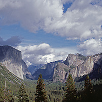 El Capitan, Cathedral Rocks & other cliffs tower over Yosemite Valley.