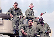 US Army soldiers sit on top of their Bradley Fighting Vehicle after the land battle begun crossing the border into Iraq during the Gulf War February 24, 1991 in Southern Iraq.
