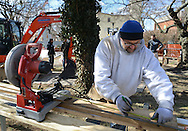 DOYLESTOWN, PA - MARCH 24:  Mike Horvath, of Warrington, Pennsylvania cuts a piece of iron before the Groundbreaking for the Global War on Terrorism memorial March 24, 2014 in Doylestown, Pennsylvania. (Photo by William Thomas Cain/Cain Images)