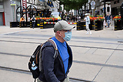 Man wearing a face mask, which became compulsory in shops on the 24th July, in the city centre on 5th August 2020 in Birmingham, United Kingdom. Coronavirus or Covid-19 is a respiratory illness that has not previously been seen in humans. While much or Europe has been placed into lockdown, the UK government has put in place more stringent rules as part of their long term strategy, and in particular social distancing.