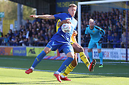 AFC Wimbledon striker Joe Pigott (39) battles for possession in the box during the EFL Sky Bet League 1 match between AFC Wimbledon and Oxford United at the Cherry Red Records Stadium, Kingston, England on 29 September 2018.