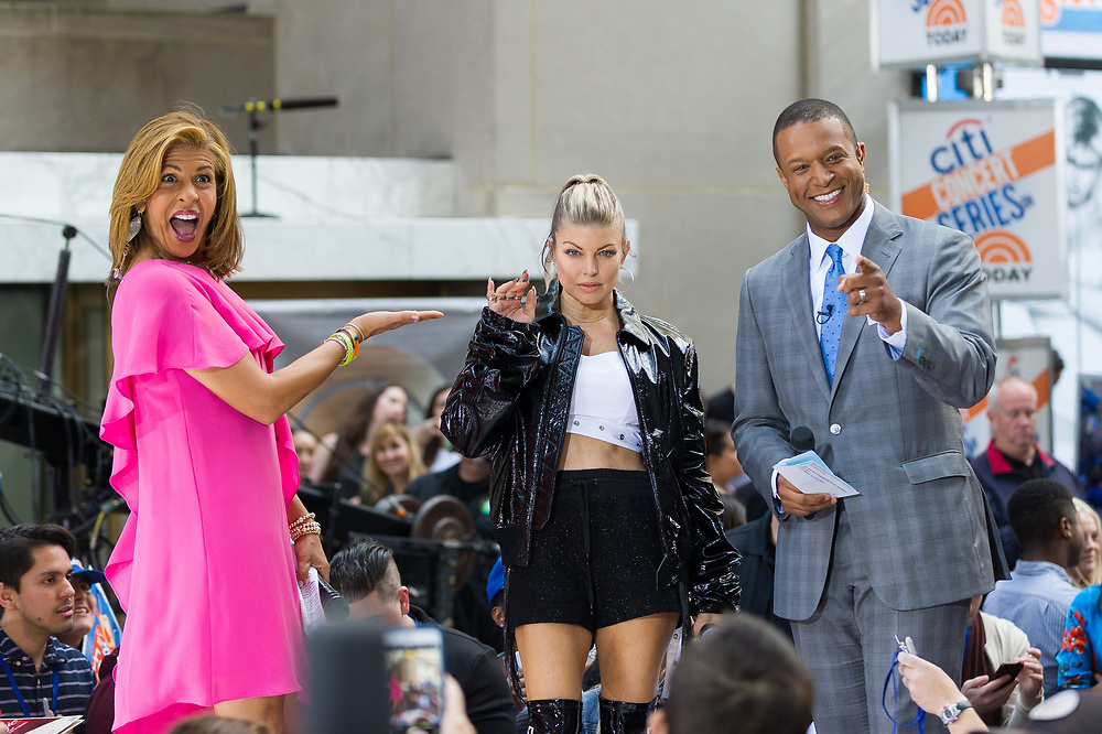 Hoda Kotb and Craig Melvin pose with Fergie between songs during her performance on NBC's The Today Show.