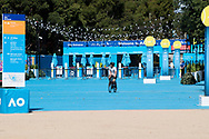 A man rides past the closed entrance of the Australian Open on the first day with no public being admitted. A snap lockdown has forced the Australian Open to be played with no crowds due to the entire state is returning to harsh stage-four lockdowns until Wednesday at 11.59pm as health authorities struggle to contain the Holiday Inn coronavirus outbreak.