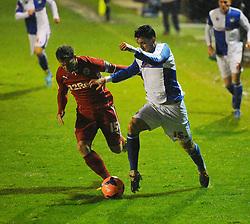 Bristol Rovers' Oliver Norburn takes on Crawley Town's Dannie Bulman - Photo mandatory by-line: Seb Daly/JMP - Tel: Mobile: 07966 386802 18/12/2013 - SPORT - FOOTBALL - Broadfield Stadium - Crawley - Crawley Town v Bristol Rovers - FA Cup - Replay
