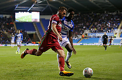 Swansea's Angel Rangel in action with Reading's Tyler Blackett (right) during the Carabao Cup, third round match at the Madejski Stadium, Reading.