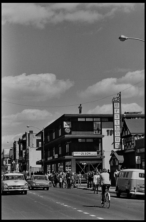 Madison, WI – May, 1970. On May 1, 1970, there was a general student strike in response to the news that the U.S. had expanded bombing into Cambodia. There was a march against the war, led by Veterans for Peace in Vietnam; and after the May 4 shootings at Kent State University in Ohio, there were more protests at UW Madison, which led to the police being called in, and teargassing demonstrators in the streets and on campus. A guard on a rooftop overlooking State Street.