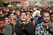 Worshippers at Friday prayers in Sadr City on 6 January 2012, the day after two explosions in the neighborhood killed twelve people.