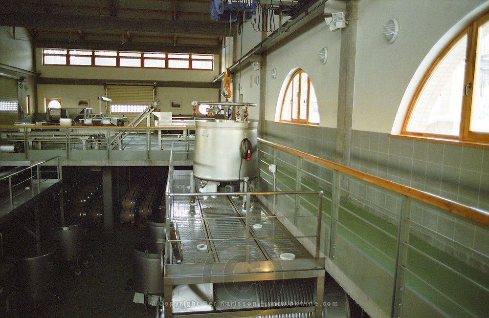 Inside the Oremus winery in Tolcsva, Tokaj - very modern wine making equipment. The round container is to collect Eszencia wine. Oremus is owned by the Alvarez family that also owns Vega Sicilia in Spain It is managed by Andras Bacso. Credit Per Karlsson BKWine.com