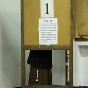 VENICE, ITALY - FEBRUARY 24:  A nun casts her vote at a Polling Station in Venice Castello as the Italian General Election gets underway on February 24, 2013 in Venice, Italy. Italians are heading to the polls today to vote in the elections, as the country remains in the grip of economic problems . Pier Luigi Bersani's centre-left alliance is believed to be a few points ahead of the centre-right bloc led by ex-Prime Minister Silvio Berlusconi.  (Photo by Marco Secchi/Getty Images)