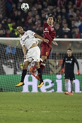 November 21, 2017 - Seville, Spain - GUIDO PIZARRO of Sevilla (L ) vies for the ball with ROBERTO FIRMINO of Liverpool ( R) during the UEFA Champions League Group E soccer match between Sevilla FC and Liverpool FC at Estadio Ramon Sanchez Pizjuan (Credit Image: © Daniel Gonzalez Acuna via ZUMA Wire)