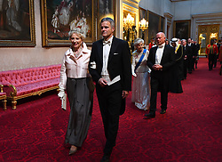 Princess Michael of Kent and Helge Lund arrive through the East Gallery during the State Banquet at Buckingham Palace, London, on day one of the US President's three day state visit to the UK.