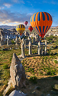"""Pictures & images of hot air balloons over the fairy chimney rock formations and rock pillars of """"love Valley"""" near Goreme, Cappadocia, Nevsehir, Turkey .<br /> <br /> If you prefer to buy from our ALAMY PHOTO LIBRARY  Collection visit : https://www.alamy.com/portfolio/paul-williams-funkystock/cappadocia-balloons.html<br /> <br /> Visit our TURKEY PHOTO COLLECTIONS for more photos to download or buy as wall art prints https://funkystock.photoshelter.com/gallery-collection/3f-Pictures-of-Turkey-Turkey-Photos-Images-Fotos/C0000U.hJWkZxAbg"""