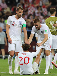 MOSCOW, July 11, 2018  England's Harry Kane (L top) and Eric Dier (C top) comfort Dele Alli (bottom) after the 2018 FIFA World Cup semi-final match between England and Croatia in Moscow, Russia, July 11, 2018. Croatia won 2-1 and advanced to the final. (Credit Image: © Yang Lei/Xinhua via ZUMA Wire)