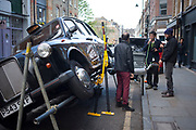 Friends smoke a shisha made from a black taxi cab exhaust pipe. This smoking contraption is just one of the bizarre, eccentric things that seem to be around every corner in London.