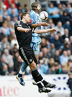Photo: Steve Bond/Richard Lane Photography.<br />Coventry City v Chelsea. FA Cup 6th Round. 07/03/2009. John Terry (L) and Leon Best (R) in the air