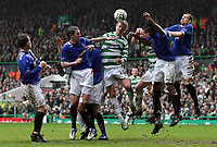 Photo: Paul Thomas.<br /> Glasgow Celtic v Glasgow Rangers. Bank of Scotland Scottish Premier League. 11/03/2007.<br /> <br /> Jiri Jarosik (C) of Celtic is surrounded by Rangers players while trying a header at goal, with no luck.