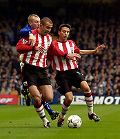 Photo. Jed Wee.<br /> Everton v Southampton, FA Barclaycard Premiership, Goodison Park, Liverpool. 19/10/03.<br /> Everton's Tony Hibbert (L) is crowded out by Southampton's Danny Higginbotham (C) and Fabrice Fernandes.