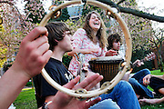 "University of Washington students (l-r) Rex Thompson, Lucy Burnett and Zach Scholl jam out on April 6, 2007 in celebration of ""Blossom Lovefest,"" held each Spring under the blooming cherry trees on the Seattle, Washington campus."